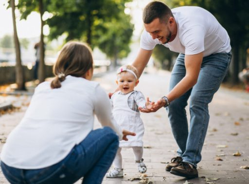 young-family-with-their-small-daughter-autumn-park_1303-10840